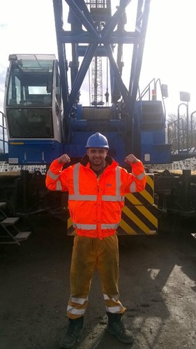 Person in front of crawler crane